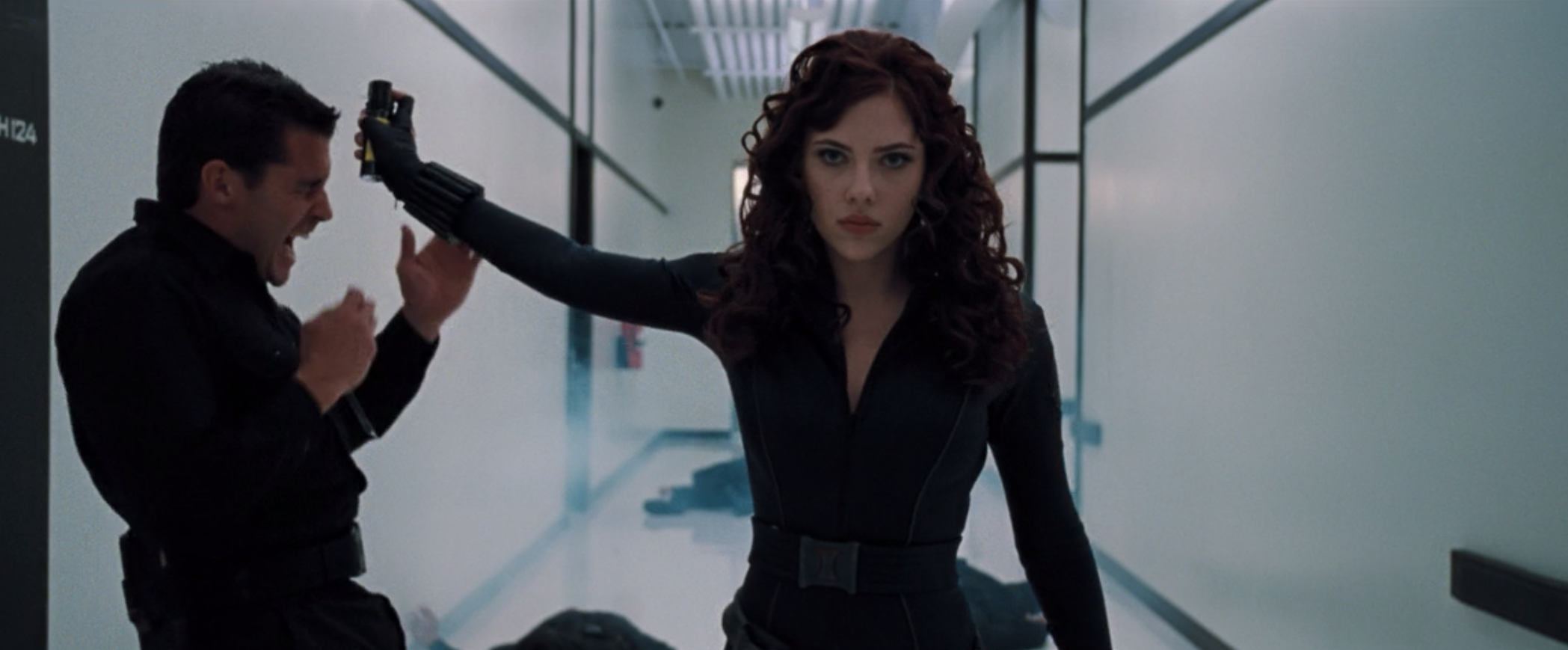 Natasha Romanoff sprays mace into the face of a bad guy who was trying to grab her.