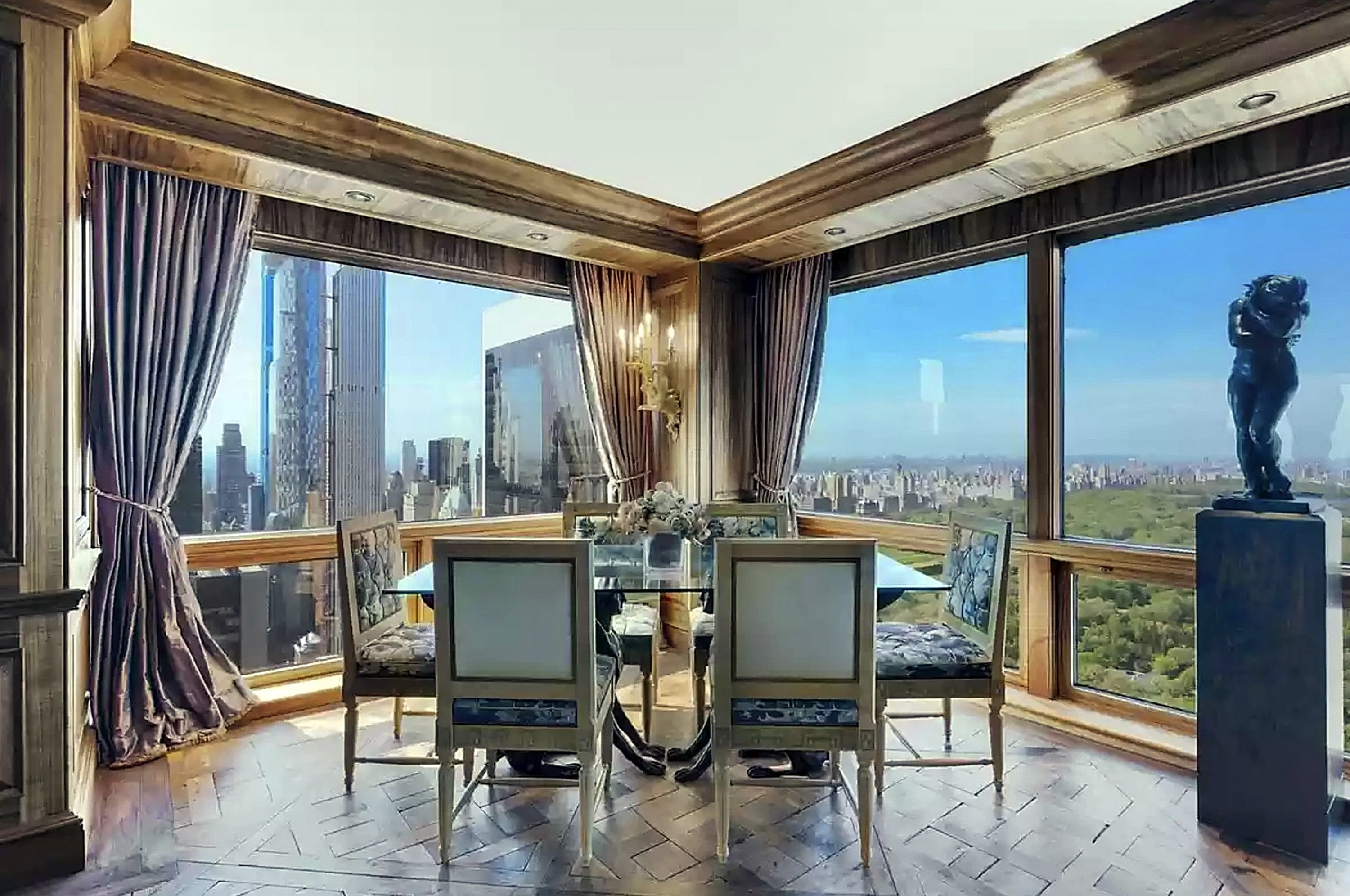 Glass-topped dining room table with uninterrupted views of skyscrapers and Central Park