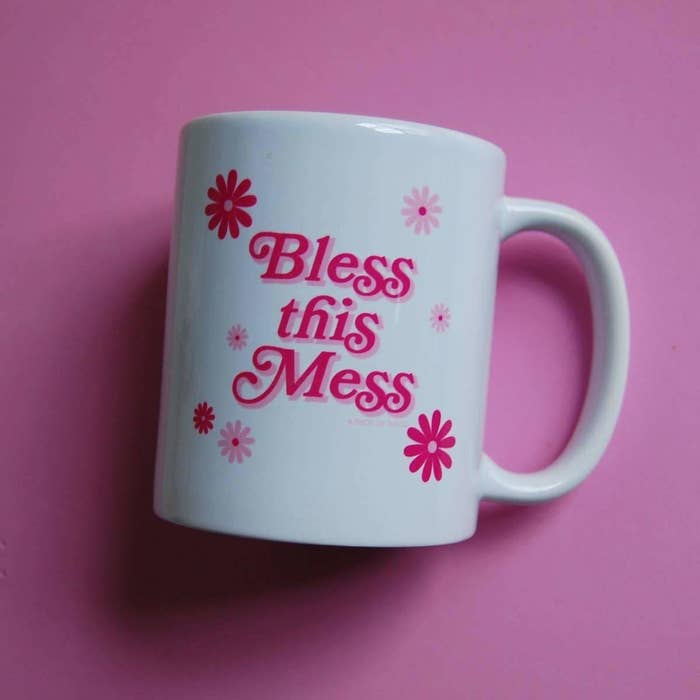 the bless this mess mug against a pink background