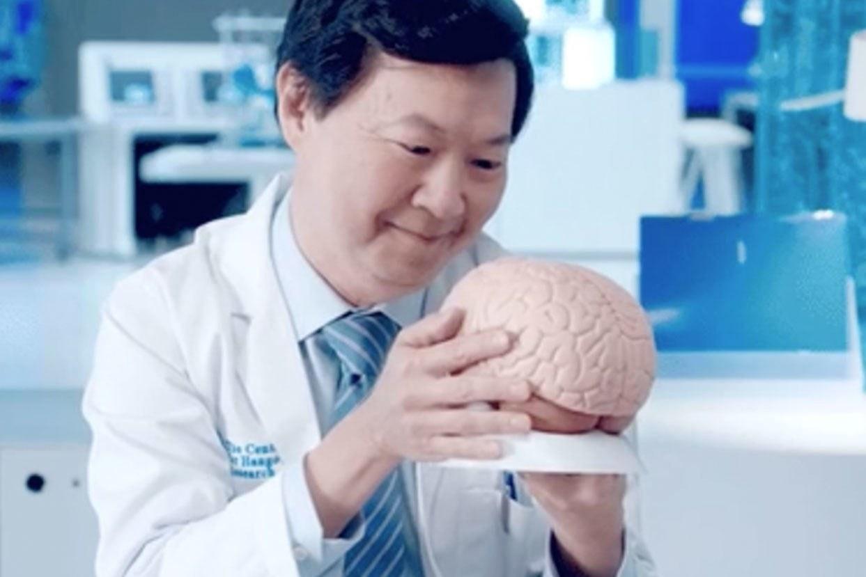 Dr. Ken Jeong looking lovingly at a brain