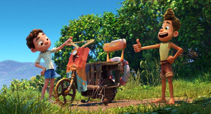 An image from the movie with Luca and Alberto admiring a janky scooter they built