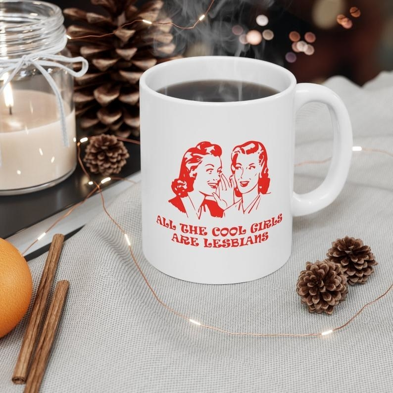 the all the cool girls are lesbians mug filled with steaming coffee