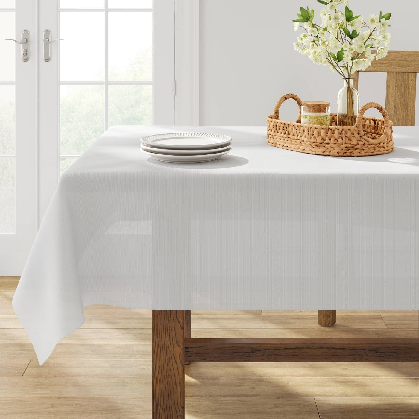 the white tablecloth on a decorated table