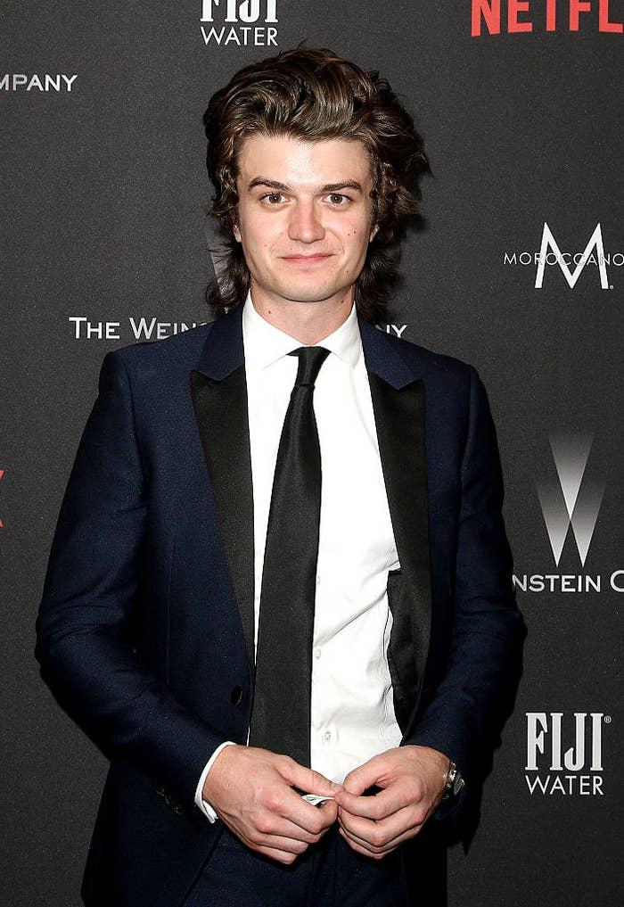 Joe Keery in a suit posing