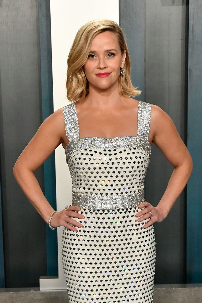 Reese Witherspoon with her hands on her hips posing