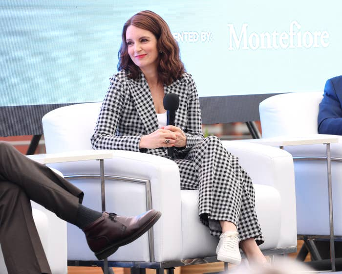 Tina Fey sits in an armchair while speaking at a Tribeca Film Festival event in New York City