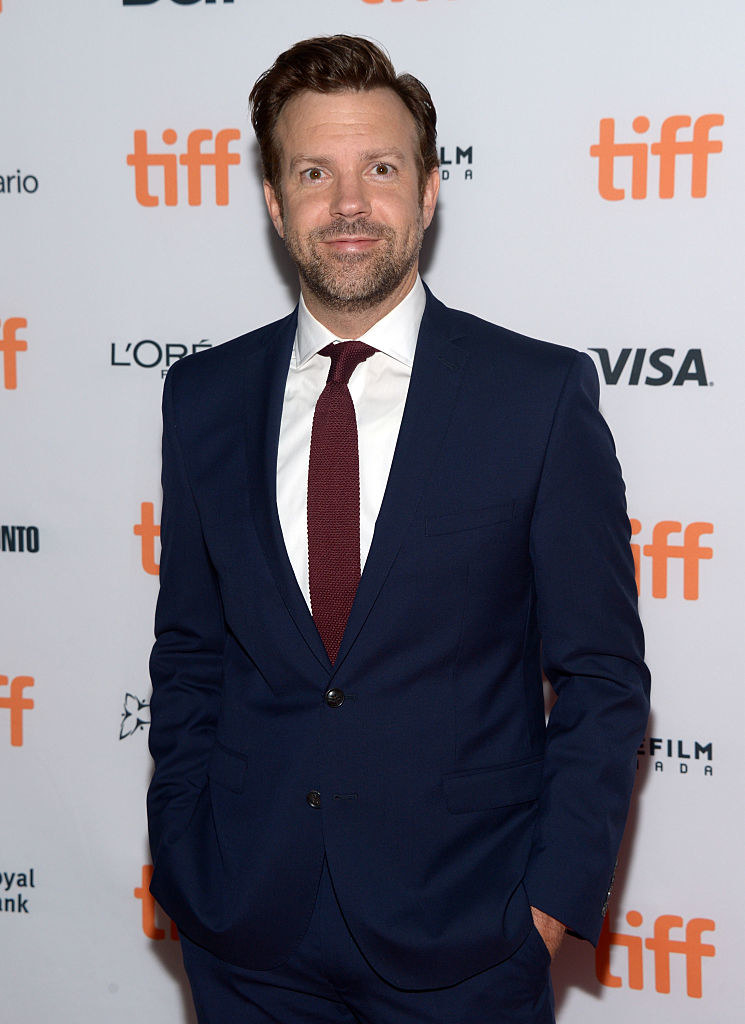 Jason Sudeikis posing in a suit