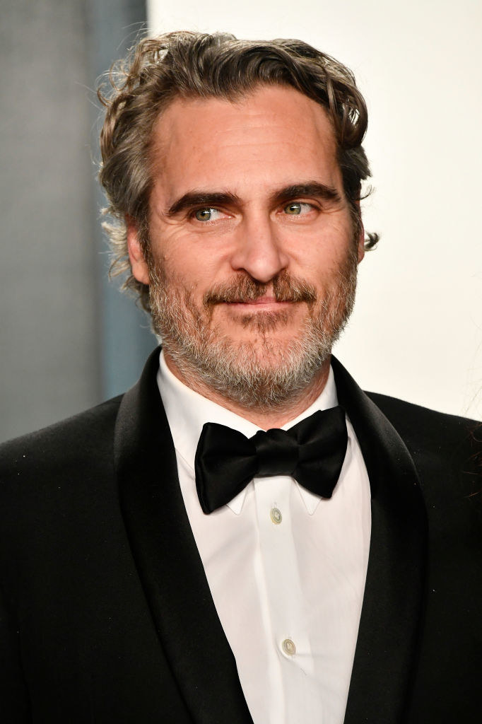 Joaquin Phoenix posing in a tux