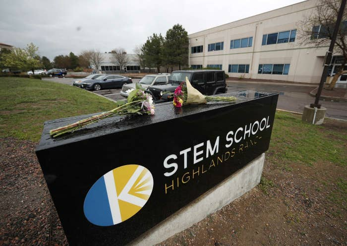 bouquet of flowers rests on sign at stem school highlands ranch in colorado