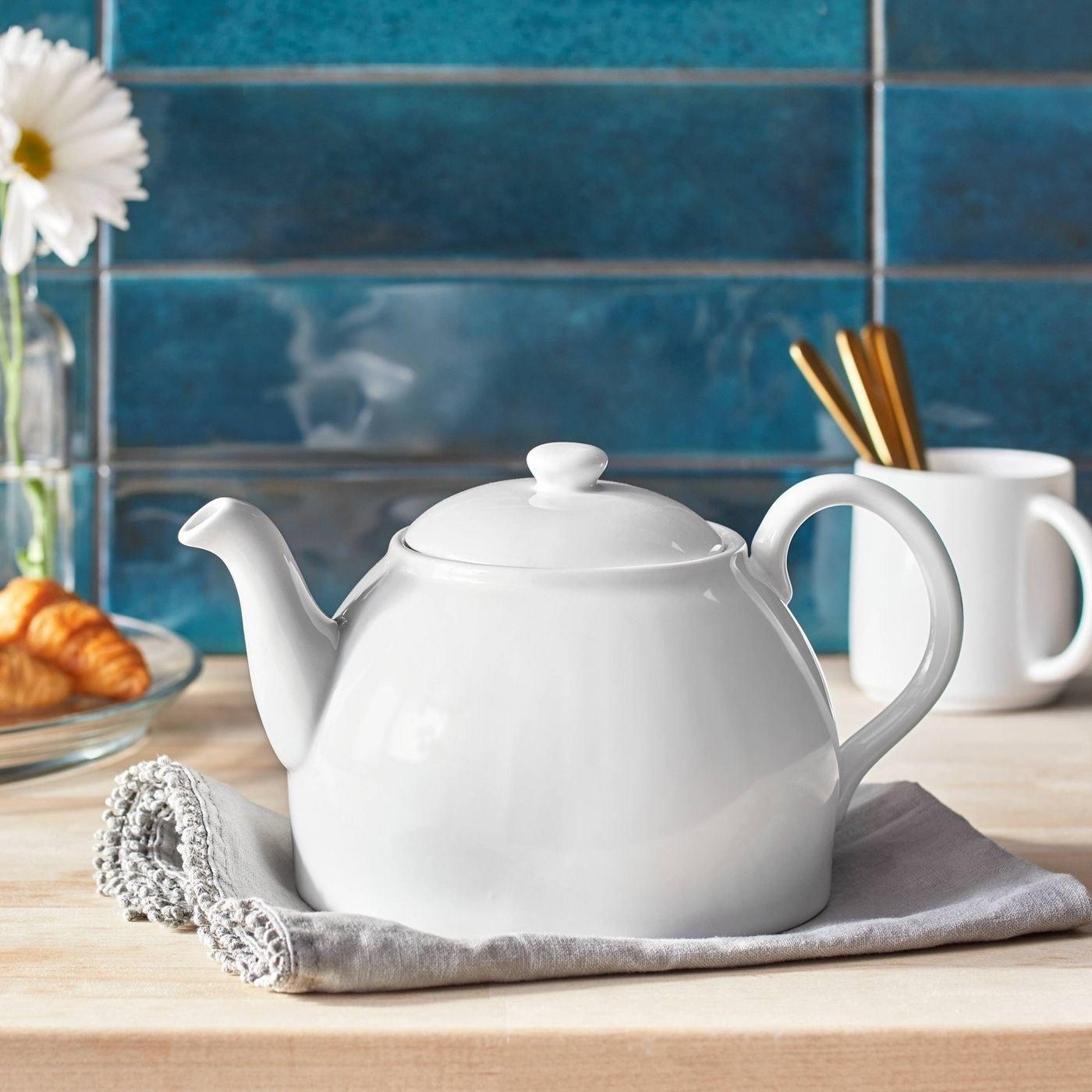 the white teapot on a napkin
