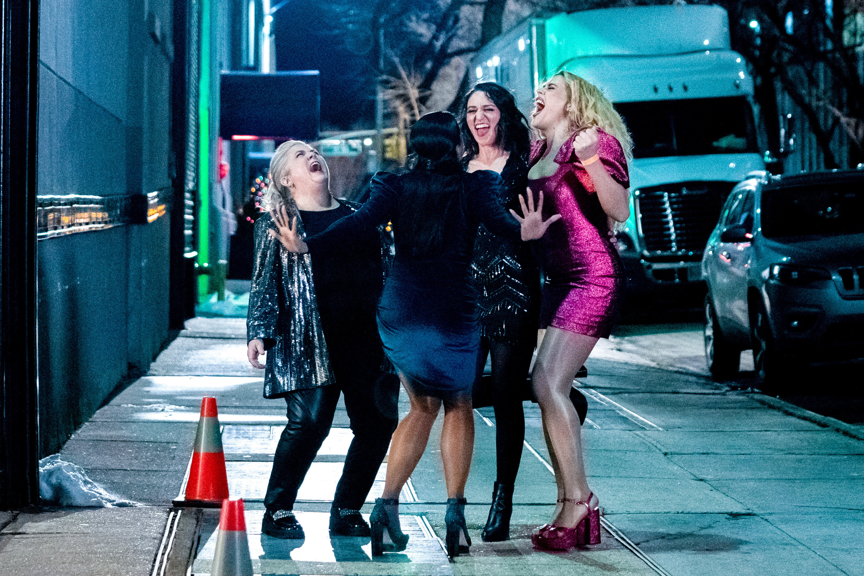 """Paula Pell, Sara Bareilles, and Busy Philipps cheer in this still image from the eighth episode of """"Girls5eva"""""""