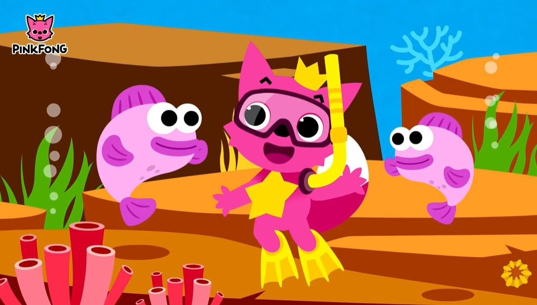 The pink fox mascot of Pink Fong swims between two purple fish while wearing scuba gear and flippers