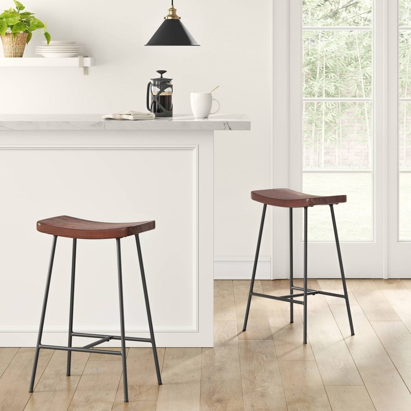 two stools next to a counter