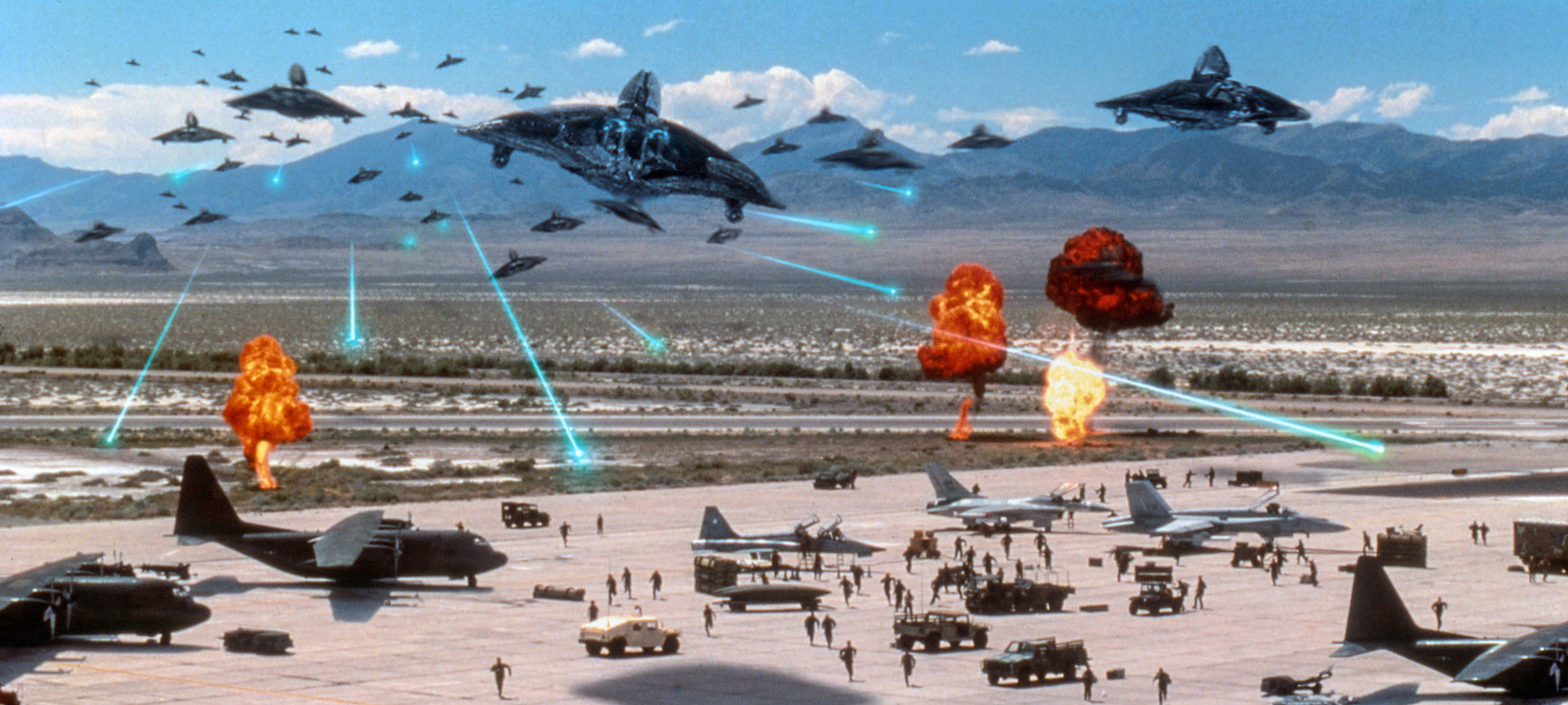 Planes lift off from an air base to fight incoming alien ships
