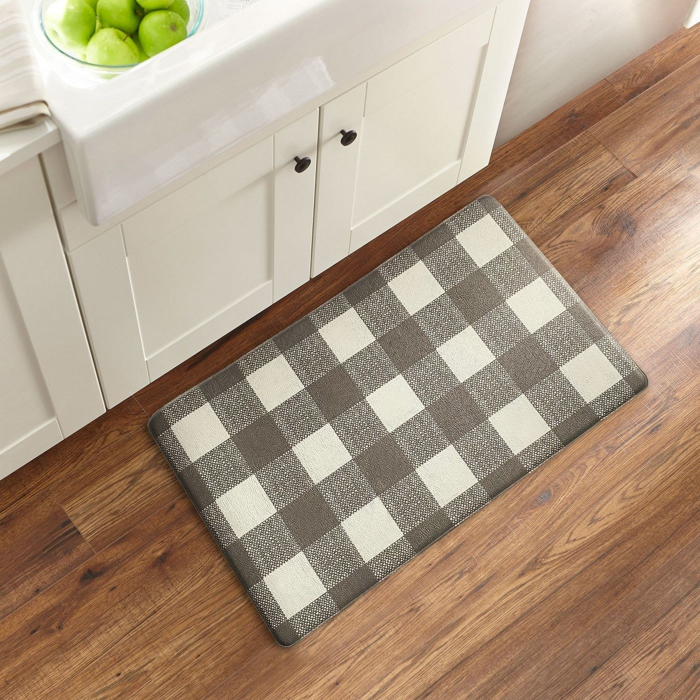 the brown gingham mat in front of a sink