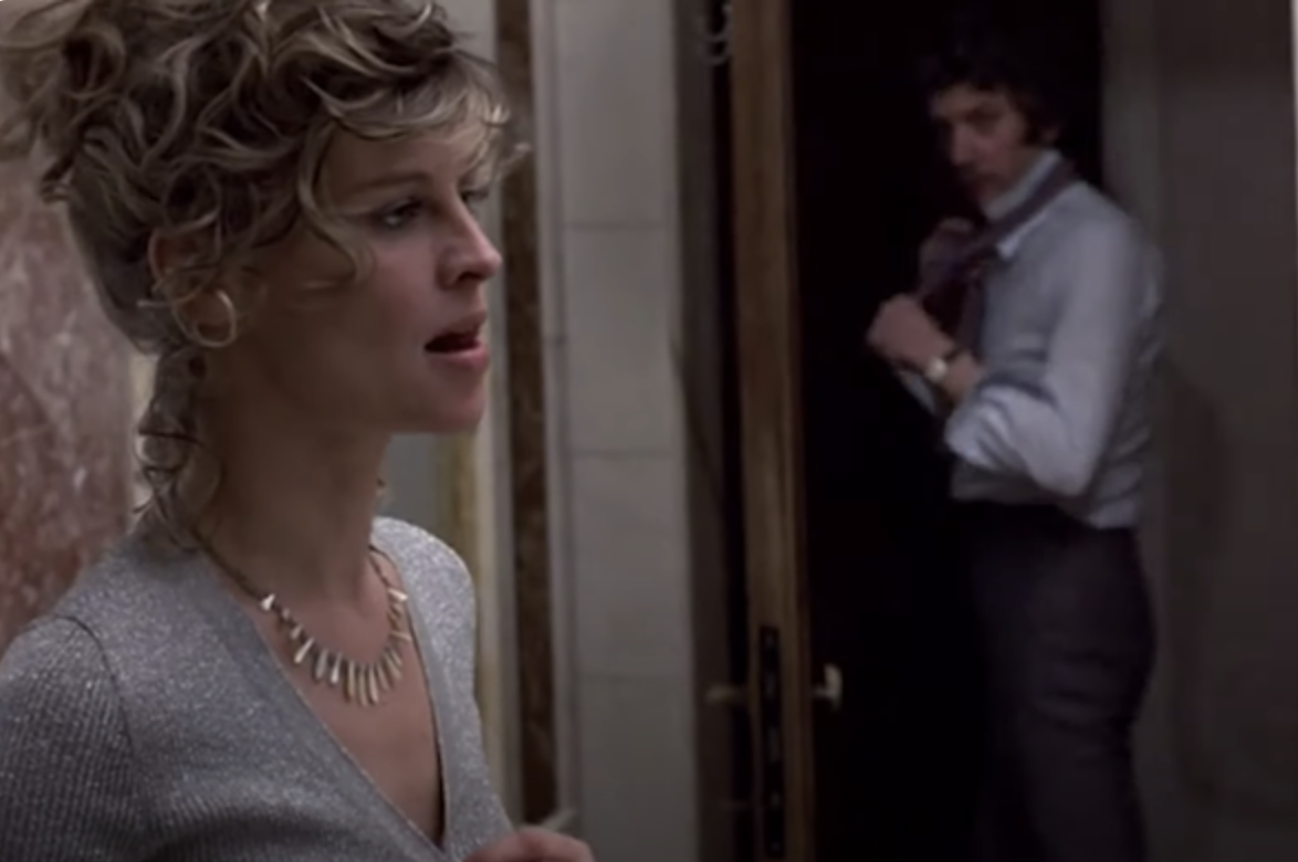 Sutherland looks at Christie, turned on, in the film
