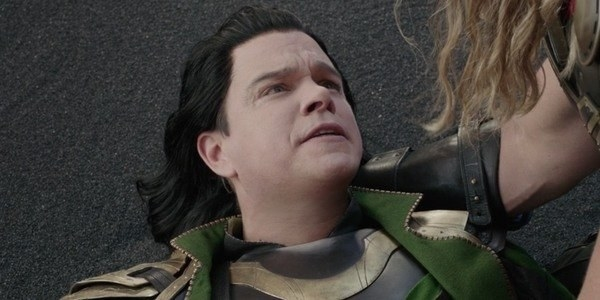 Thor holding fake Loki in his arms on the beach
