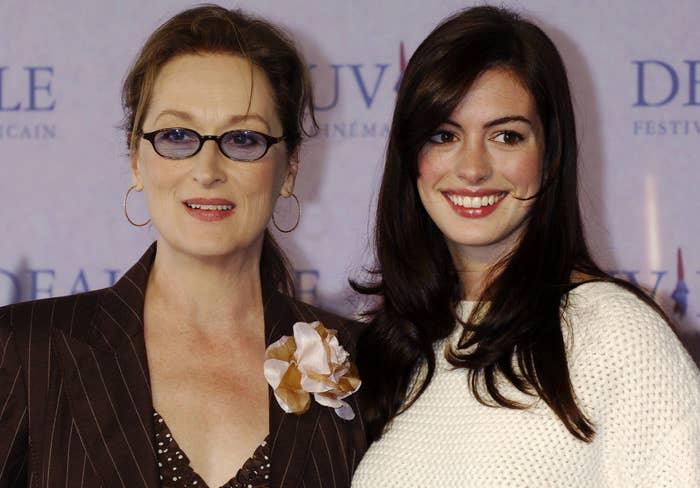 Anne poses with co-star Meryl Streep