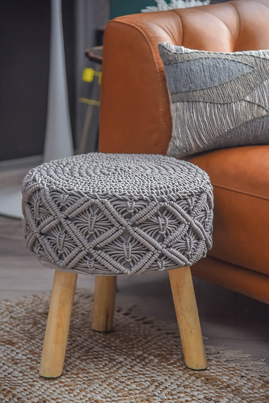 A grey macrame three-legged stool.