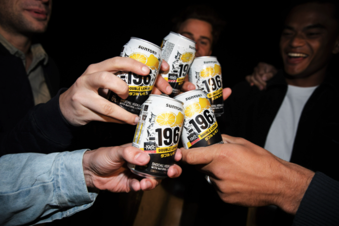 A close up of hands holding cans of Minus 196 Double Lemon