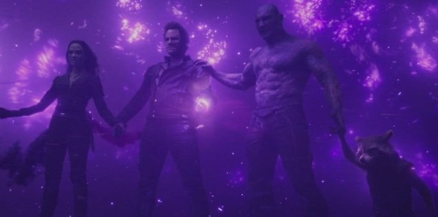 Groot, Gamora, Star-Lord, Drax, and Rocket all hold hands to disperse the energy of the powerful Power Stone.