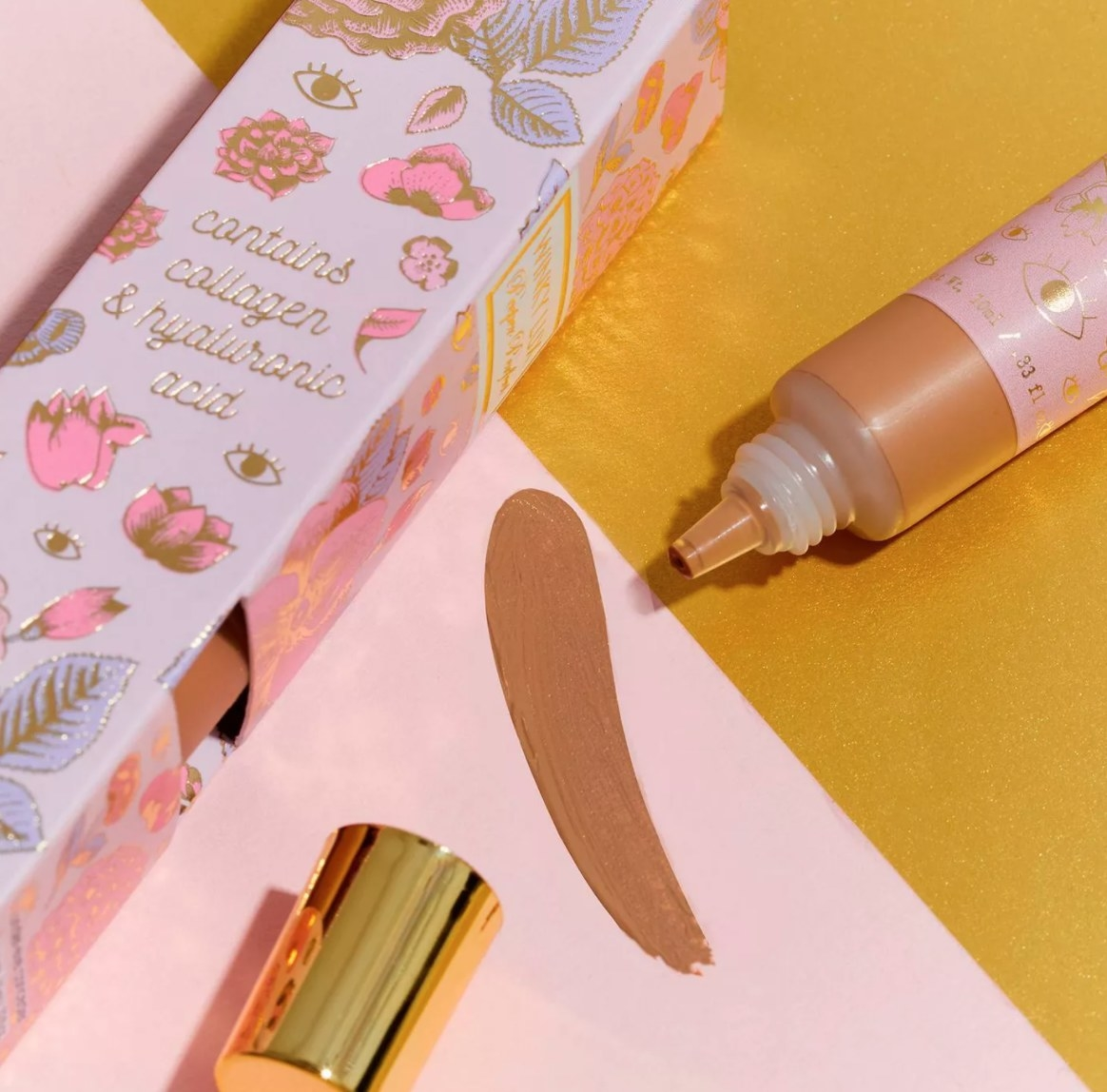 open tube of winky lux concealer next to box