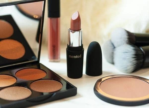 mented lipstick next to eyeshadow palette