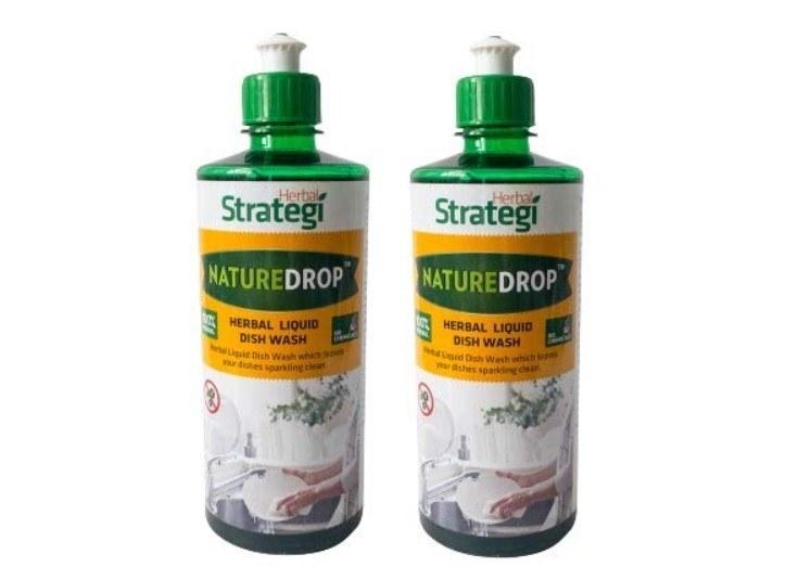 Two bottles of herbal dishwashing liquid.