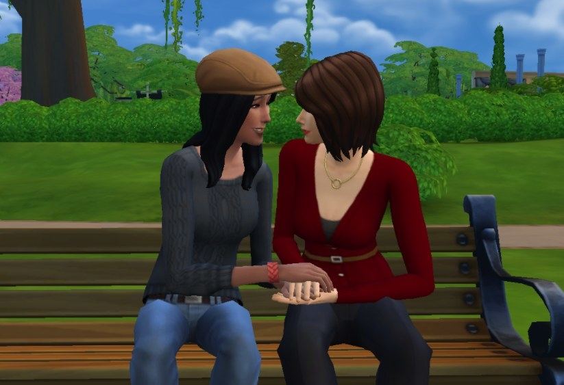 two sims sitting on a bench holding hands