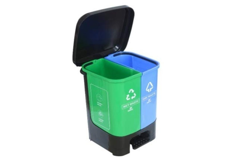 A black, green, and blue dustbin with separate compartments for wet and dry waste.