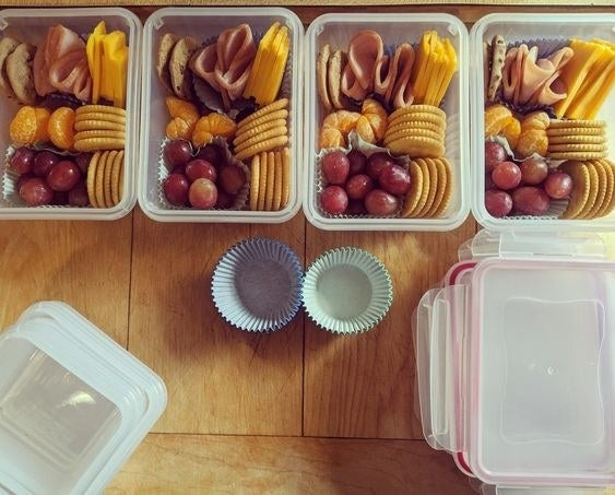 The reviewer's photo of the pack of 12 food storage containers holding meals