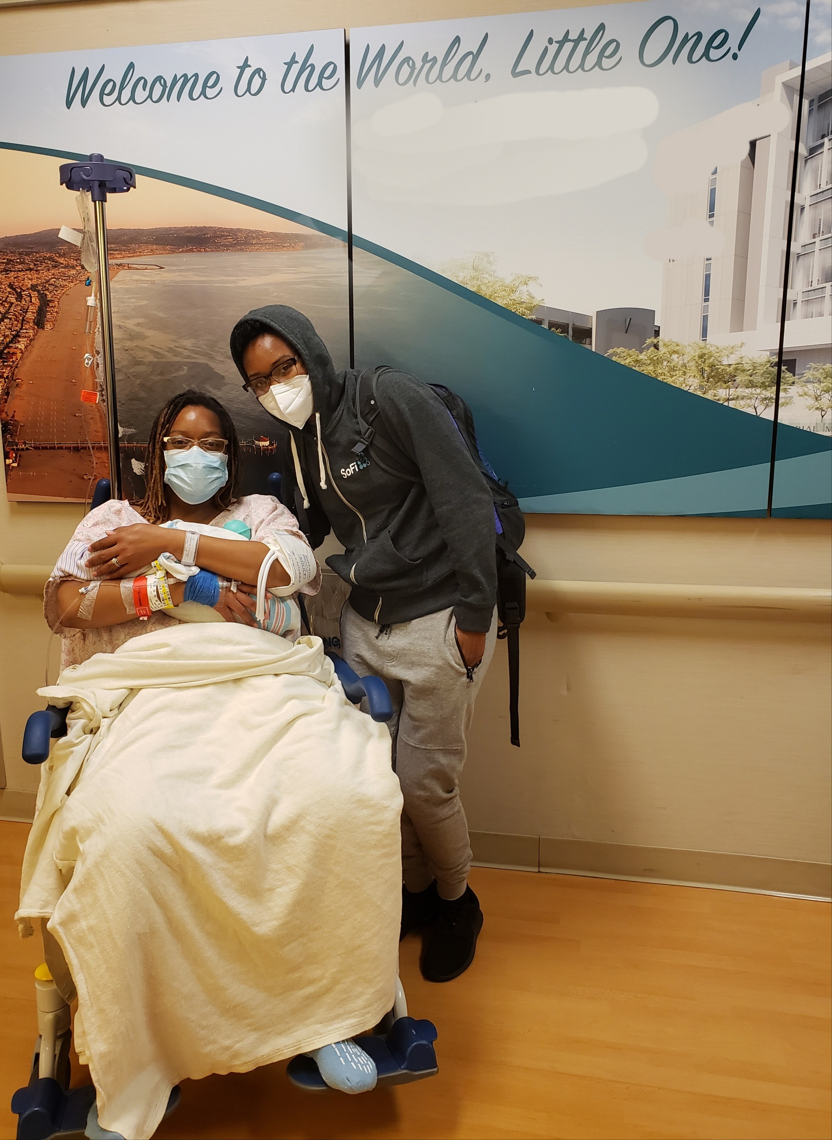 Precious and her wife in the hospital shortly after their baby's birth