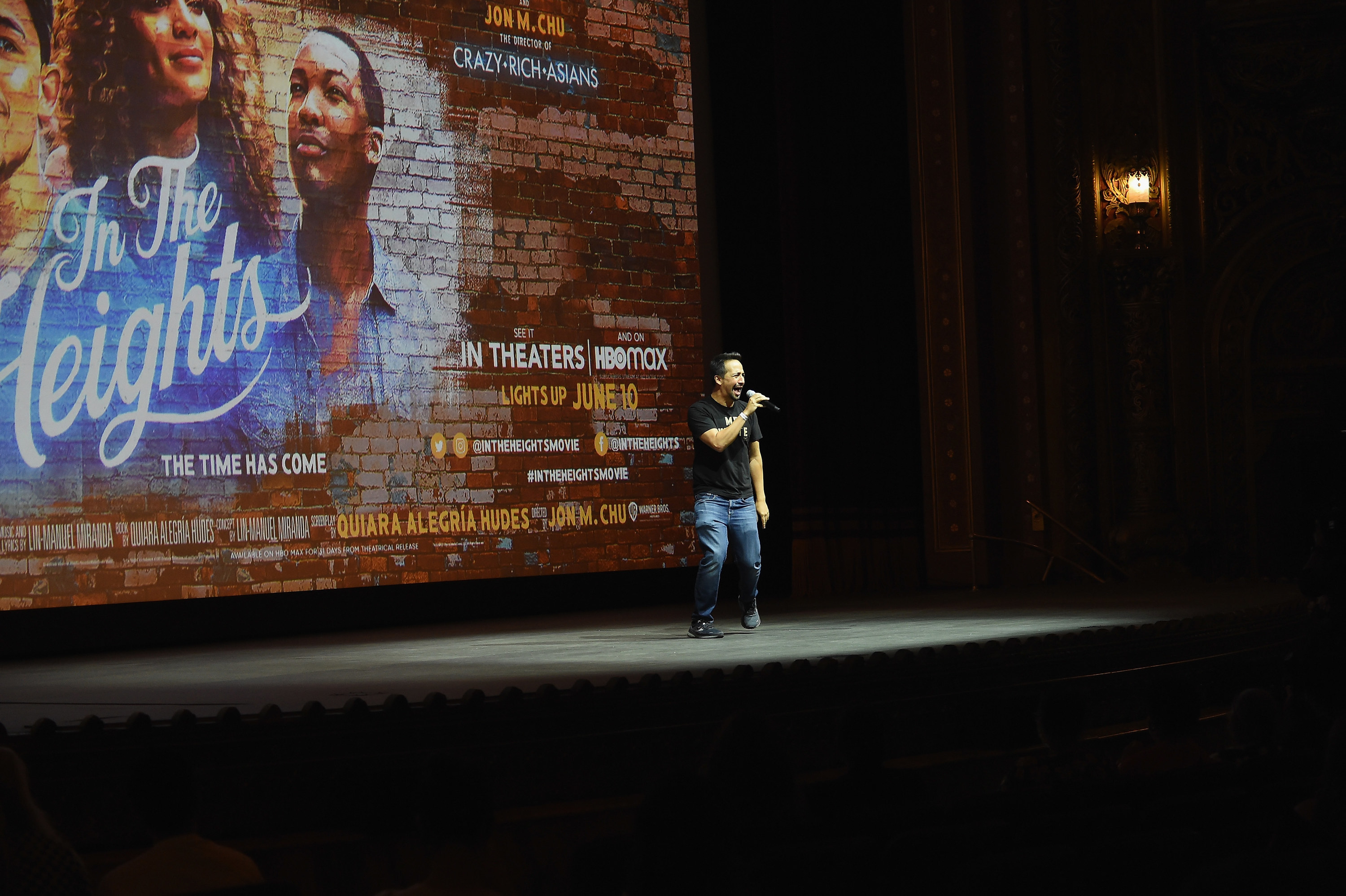 """Actor/playwright/composer Lin-Manuel Miranda speaks onstage before a free screening of """"In the Heights"""" at United Palace Theater on June 10, 2021 in New York City"""