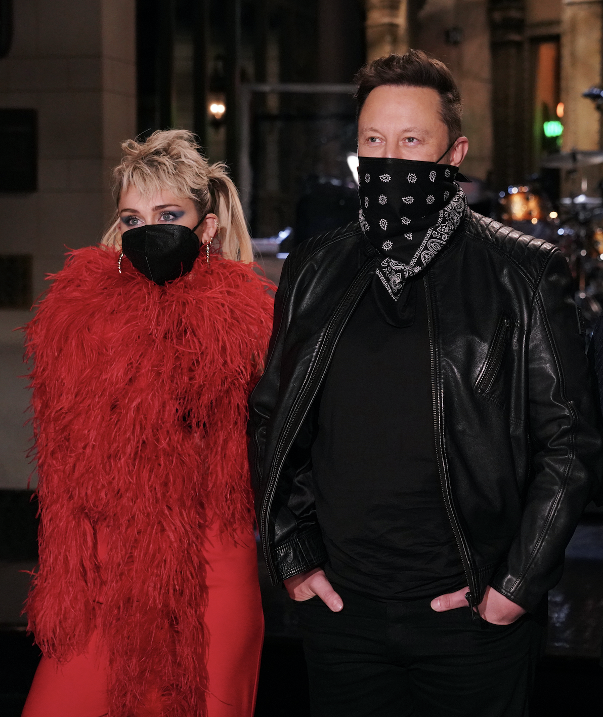 """Musical guest Miley Cyrus, host Elon Musk, and Cecily Strong pose during """"SNL"""" Promos in Studio 8H on Thursday, May 6, 2021"""