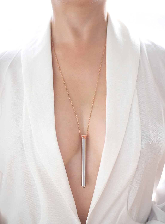 Model wearing vibrator pendant necklace