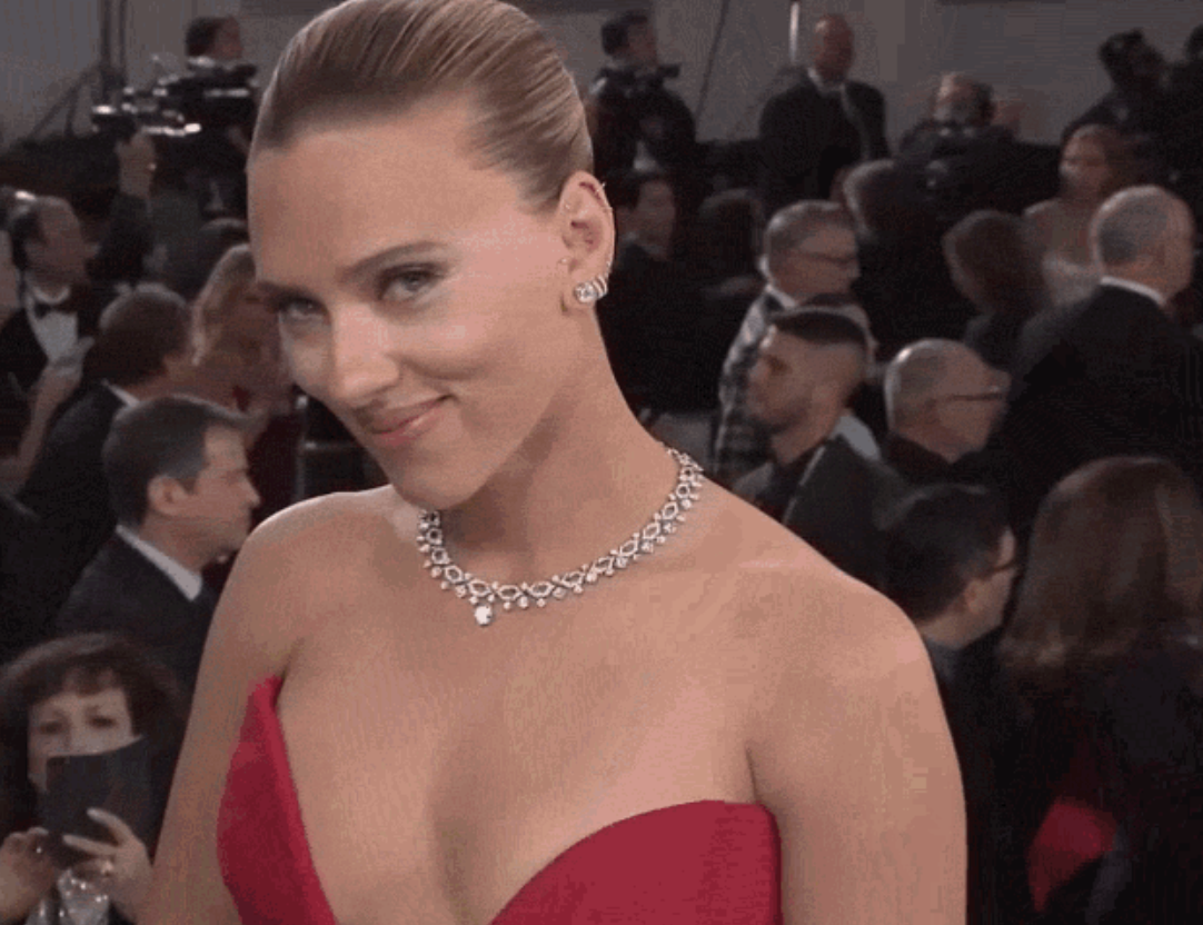 """Scarlett Johansson being interviewed on a red carpet by """"Entertainment Tonight"""""""