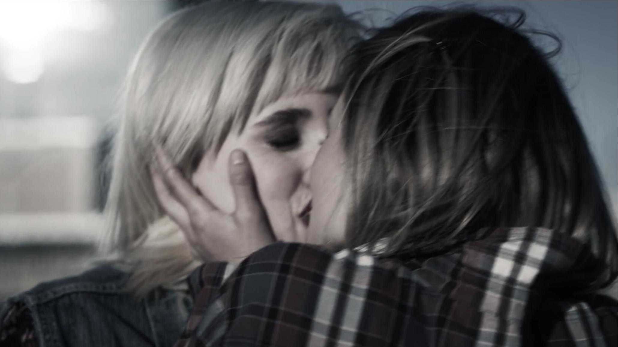Kate and Mallory kissing