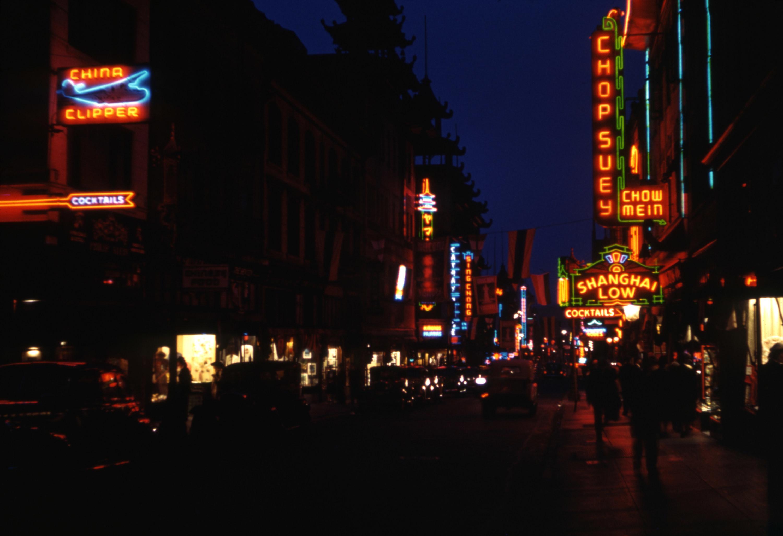 A busy street with a bar
