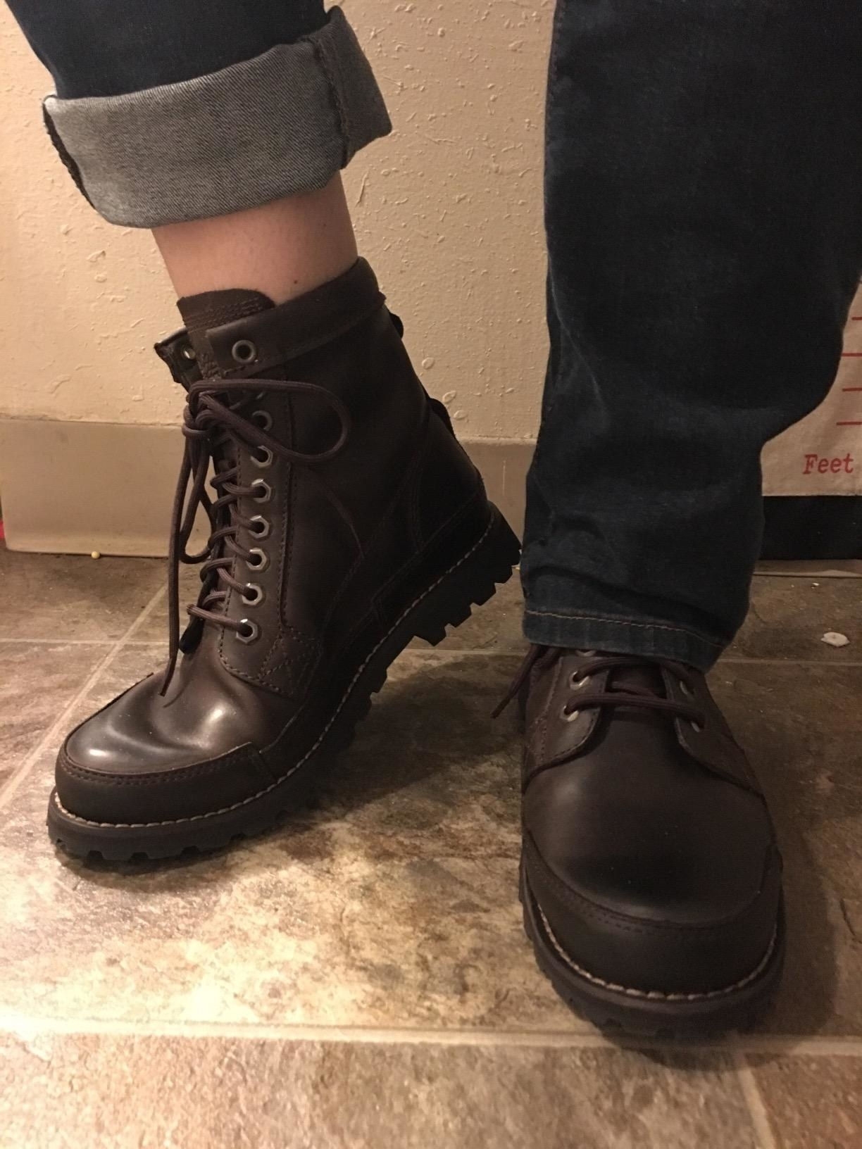 reviewer photo wearing the boots in dark brown