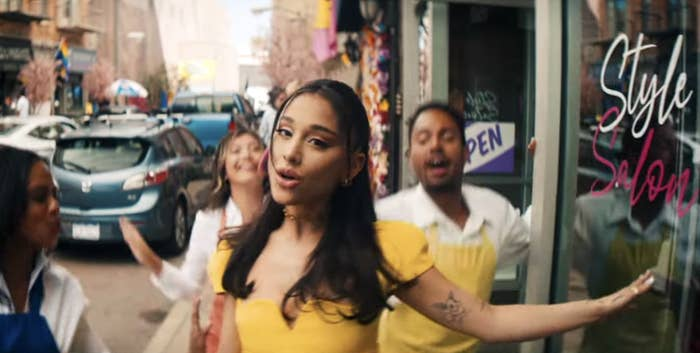 Ariana wears a yellow dress