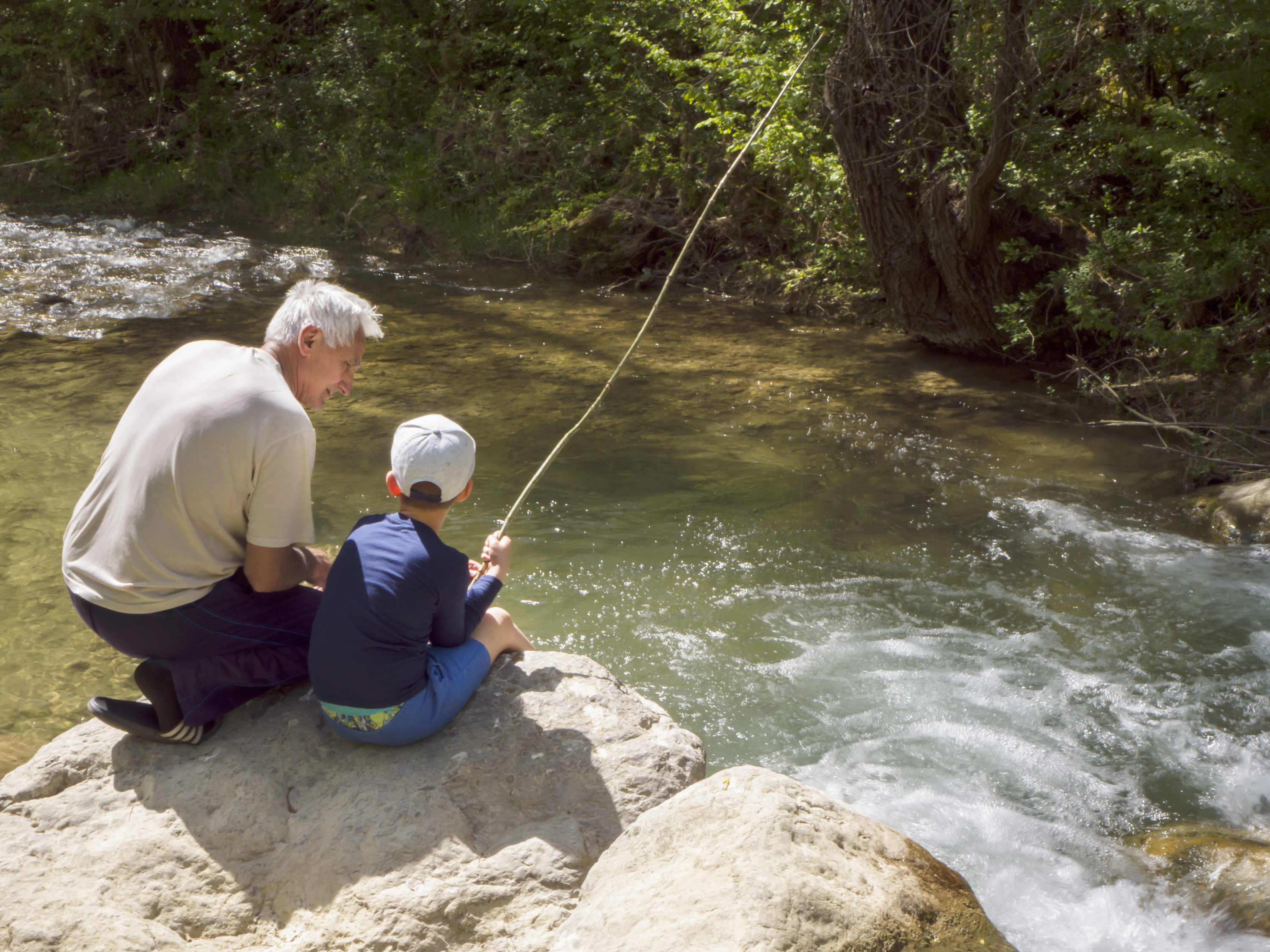 An old man and young boy fishing