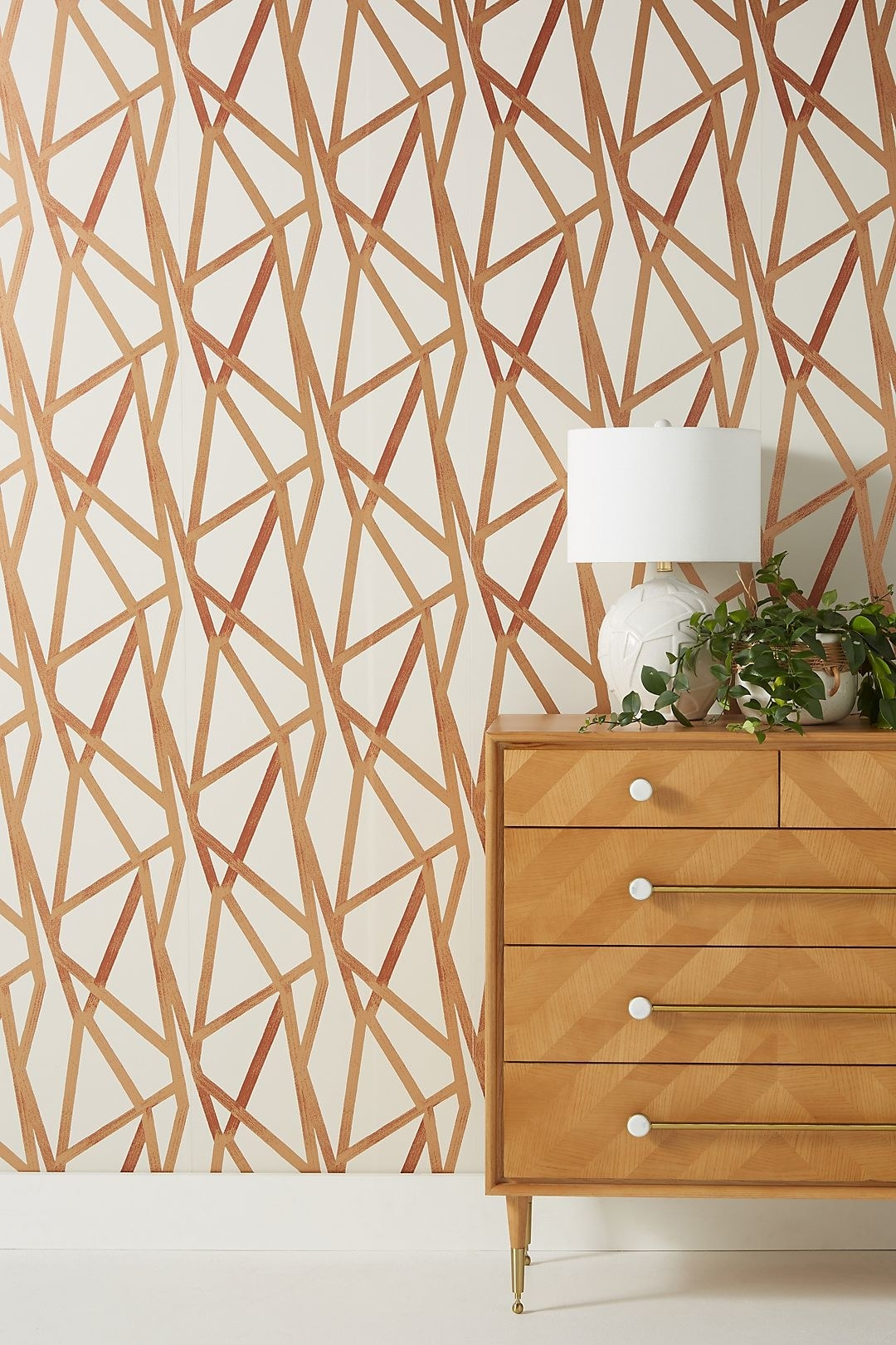 the geometric removable wallpaper that is cream with bronze shapes on top