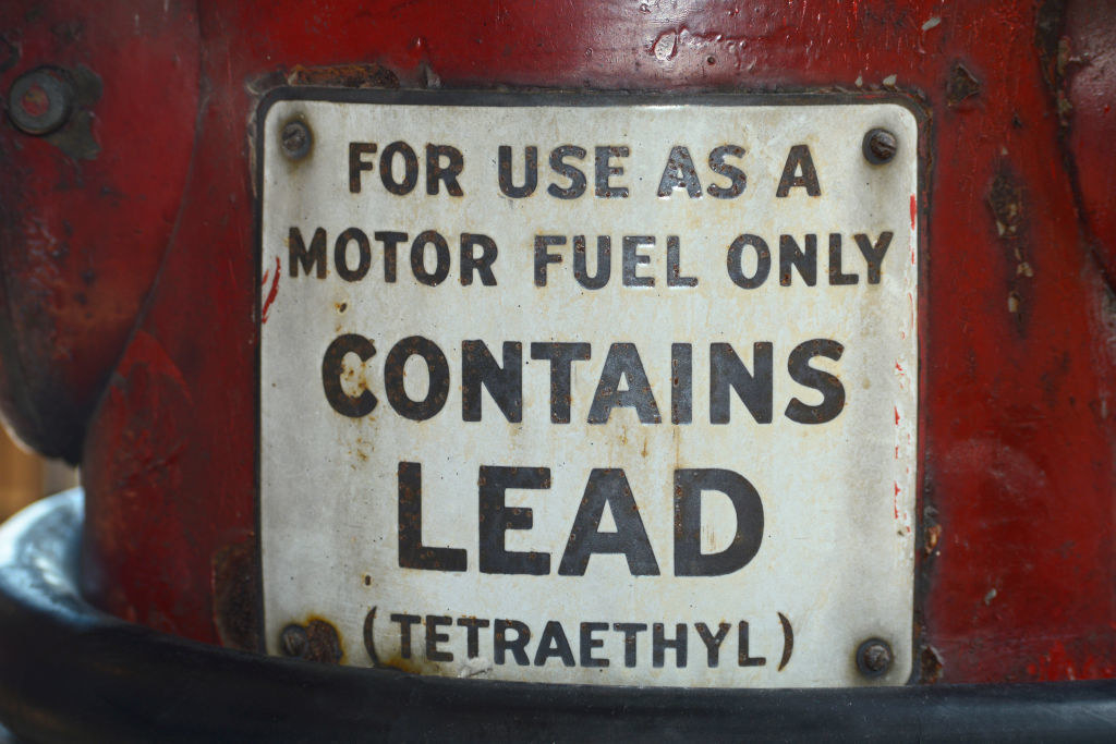 motor fuel with a label saying it contains lead