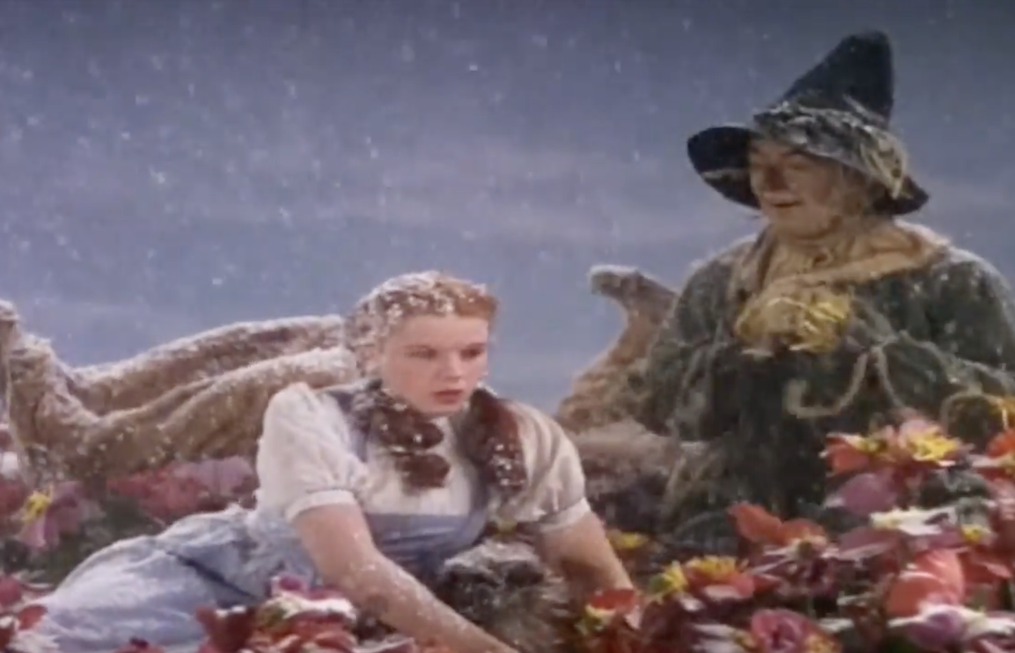 snow falling on Dorothy and the Scarecrow in The Wizard of Oz