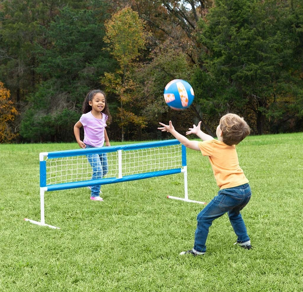Two kids playing volleyball