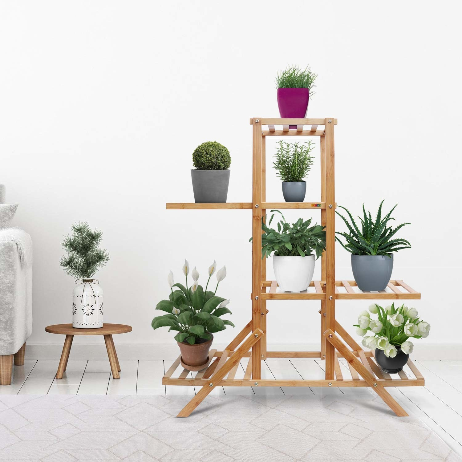 A wooden rack with shelf space in the middle and randomly protruding shelf spaces on either side. Pictured here with planters.
