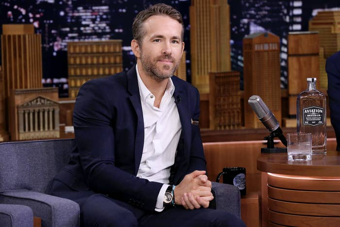 """Actor Ryan Reynolds sits on a couch during an interview on """"The Tonight Show Starring Jimmy Fallon"""""""