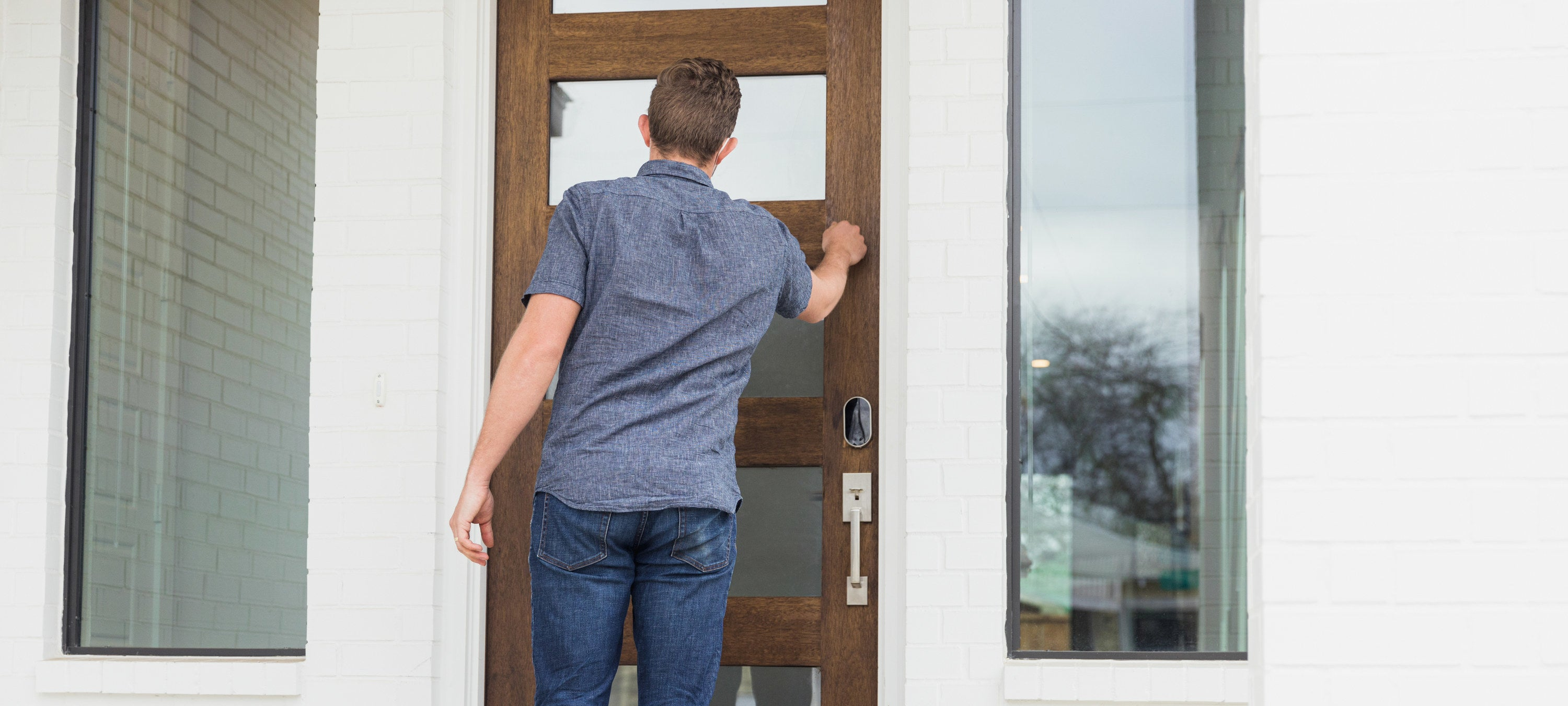 A man knocking on the door