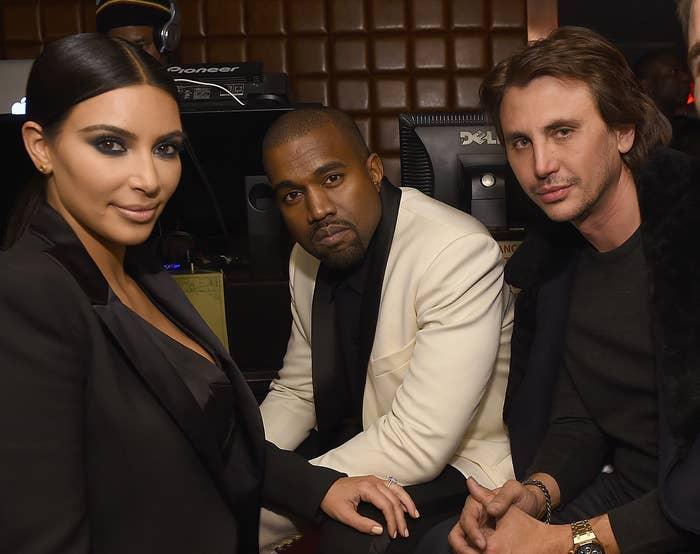 Kim and Kanye sit next to Jonathan at a club