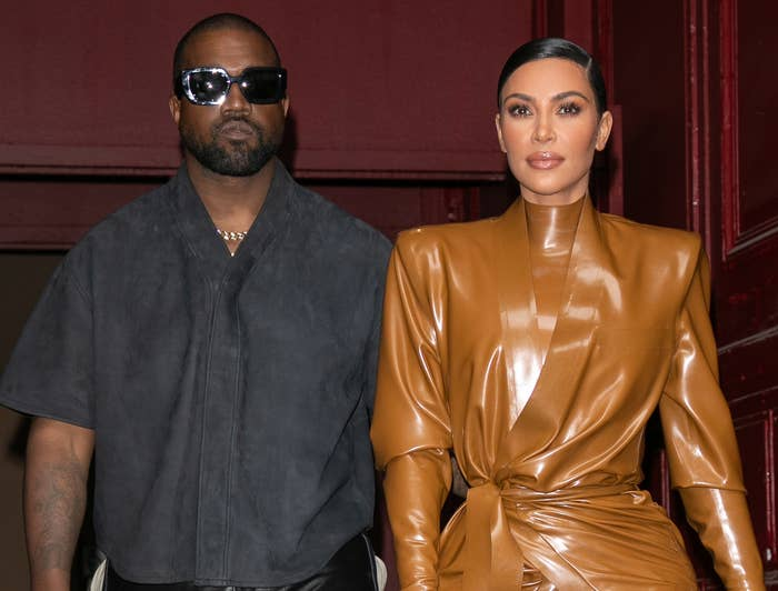 Kim and Kanye look serious while exiting a building